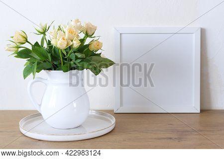 Square Wooden Frame Mockup On A Vintage Bench, Table. Modern White Ceramic Vase With White Roses. Wh