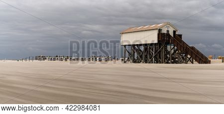 Sankt Peter-ording, Germany - 26 May, 2021: Panorama View Of Beachfront Buildings On Stilts On The W