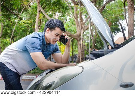 Man Holding A Black Smartphone Call An Insurance Company Or A Mechanic For Help. Because He Had An A
