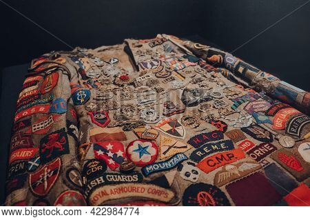 Brussels, Belgium - August 17, 2019: Uniform Patches On A Jacket In The War, Occupation, Liberation