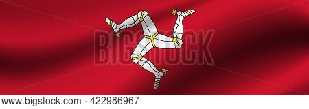 Banner With The Flag Of Isle Of Man. Fabric Texture Of The Flag Of Isle Of Man.