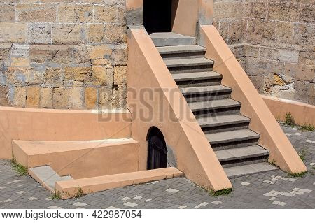 Stone Building Historical Fortress With Stairs Up And Down To Enter The Tower From The Courtyard Wit