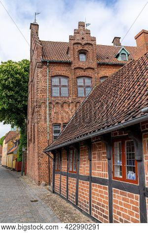 Beautiful Historic Half-timber Houses And Brick Buldings Line A Cobblestone Street In Ribe