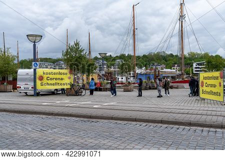 Flensburg, Germany - 27 May, 2021: People Wait For Covid-19 Tests At A Test Center Advertising