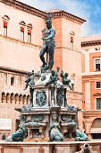 Fountain of Neptune on Piazza del Nettuno with Salaborsa on background in Bologna Italy poster