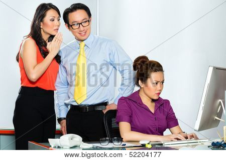 Asian Business people in office gossiping about each other or mobbing