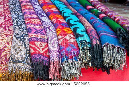 Pile of gentle folded shawls (scarfs) at the market, Pokhara, Nepal.