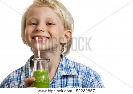 Cute Boy Drinking Green Smoothie Smiling
