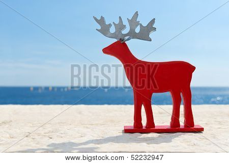 Red reindeer on vacation. Red reindeer by the sea. poster