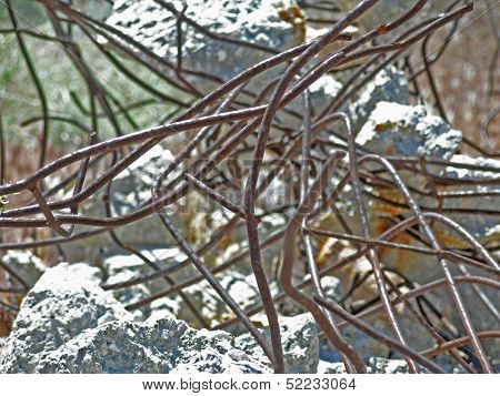 Desert twisted mangled rusted wire and concrete
