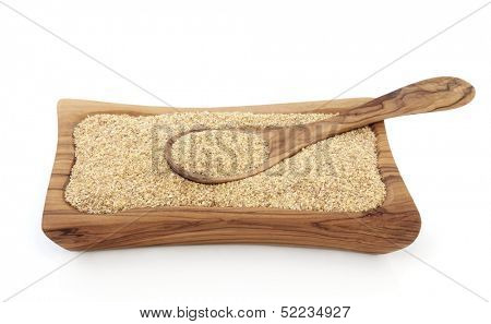 Wheatgerm health food in an olive wood bowl with spoon.