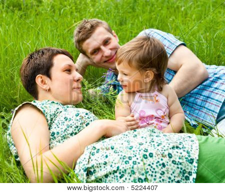 Family In The Grass