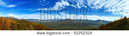 panarama of mountain valley under blue sky
