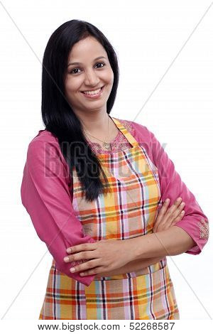 Portrait Of Young Woman With Kitchen Apron Against White