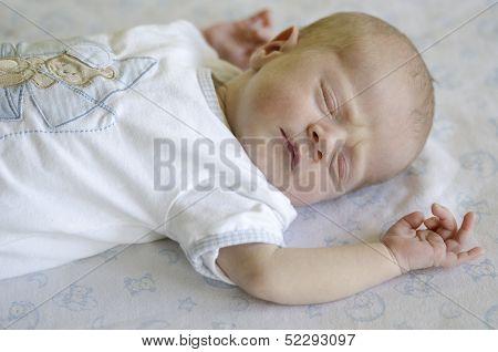 Cute Baby Sleeping On Its Back