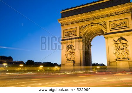 arc triomphe arch of triumph at night with car streaks in the center of the Place Charles de Gaulle also known as Place de'l Etoile in Paris France on the Champs-Elysees poster
