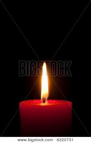 A Red Candle In Front Of Black Background,  Isolated