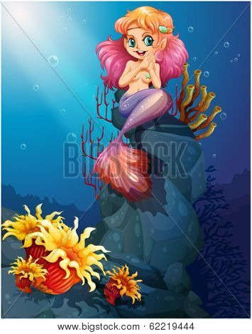 Illustration of a smiling mermaid sitting above the rocks