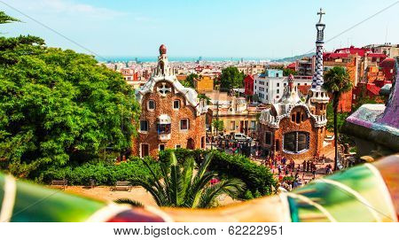 BARCELONA, SPAIN - JULY 19: Ceramic mosaic Park Guell on July 19, 2013 in Barcelona, Spain. Park Guell is the famous architectural town art designed by Antoni Gaudi and built in the years 1900 to 1914