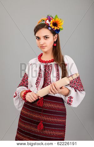 Housewife With Rolling Pin. Woman Wears Ukrainian National Dress