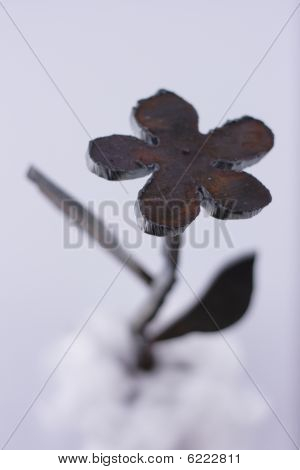 Close-up metallic artificial flower crafted by autogenous welding