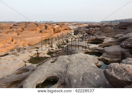 Sampanbok (3000 Hole), The Amazing of Rock in Mekong River, Ubon Ratchathani, Thailand.