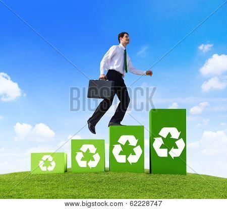 Environmentalist Businessman Running Up Recycling Steps