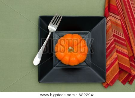 Mini Pumpkin On A Plate With Copy Space