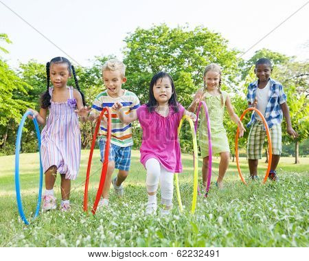 Diverse Children Playing With Hula Hoops in the Park