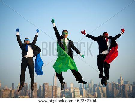 Multi-ethnic Superhero Businessmen Jumping Over New York City