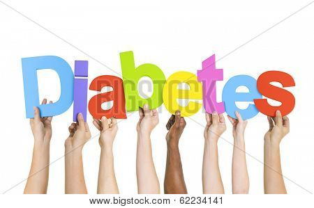 Multi-Ethnic Group Of Diverse People Holding Letters That Form Diabetes