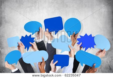 Diverse Hands Holding Blue Speech Bubbles