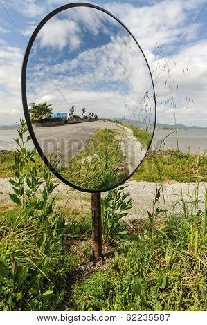 Round Mirror On A Pole By The Road
