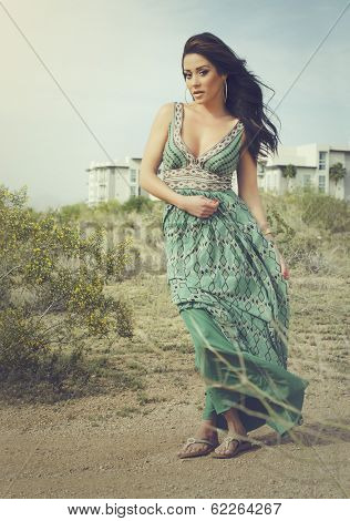 Ethereal woman posing in desert landscape Spring sunlight.  Full length photo - soft haze fashion fell to image.