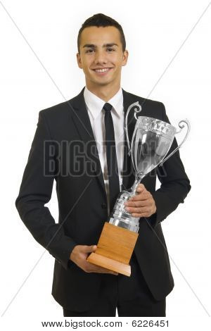 A Man With Suit Holding A Cup