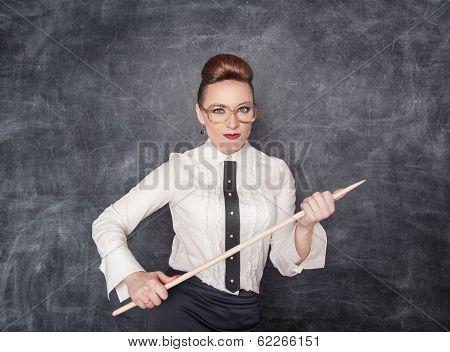 Strict Teacher With Wooden Pointer