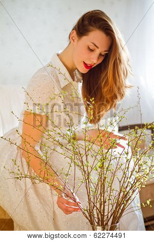 Beautiful Girl With A Bouquet Of Willow Indoors
