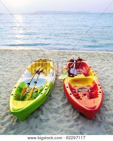 Canoes On The Beach.