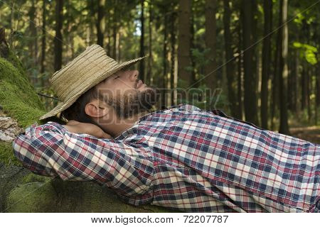 Young Man Relaxing In Nature