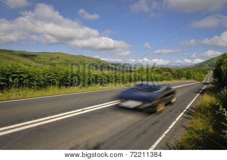 Speeding Sports Car On Mountain Road