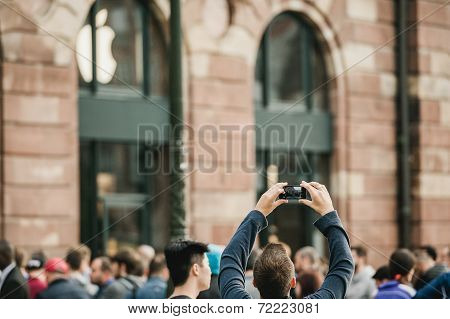 Man Photographing Iphone Launch