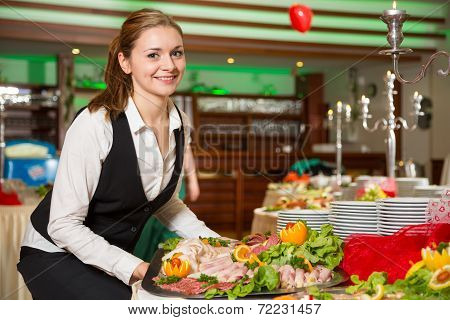 Catering Service Employee Preparing A Buffet