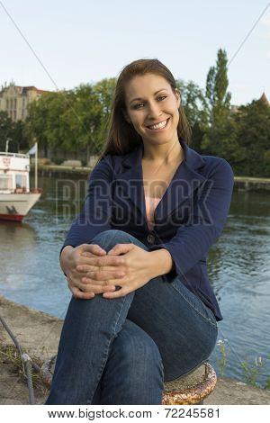 Portrait Of A Beautiful Woman At Urban Riverside