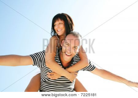 Happy young couple having fun outdoors.