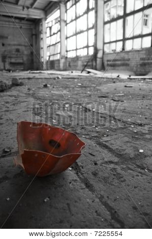 Abandoned Industrial interior with red object