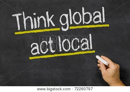 Blackboard with the text Think global - act local