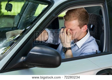 Tired Businessman Driving A Car