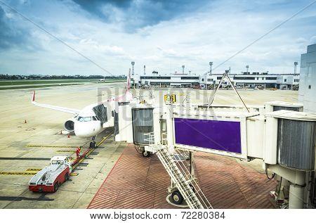 Airplane Near The Terminal