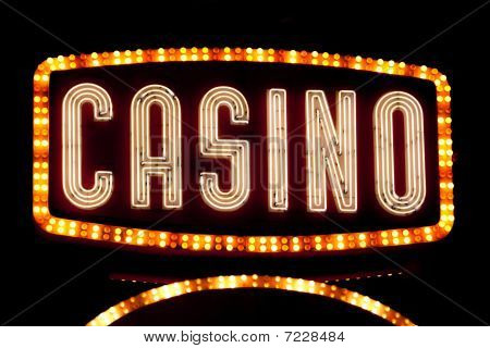 Bright shiny casino sign in neon lights poster