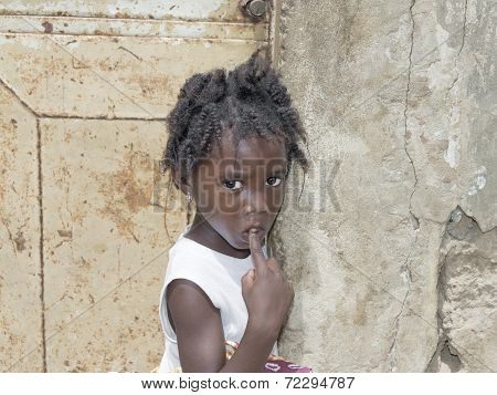 Unidentified Senegalese girl in front of a house door